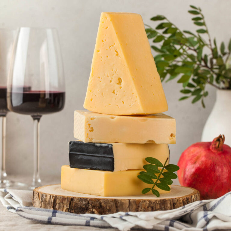 assorted-cheeses-on-a-wooden-board-and-a-linen-tab